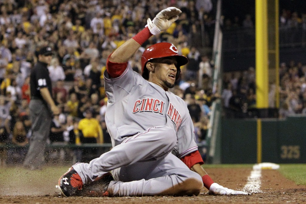 Cincinnati Reds' Billy Hamilton scores the second of two runs on an infield single by Devin Mesoraco off Pittsburgh Pirates relief pitcher Mark Melancon during the ninth inning a baseball game in Pittsburgh on Friday, Sept. 20, 2013. The Reds won 6-5 in 10 innings.