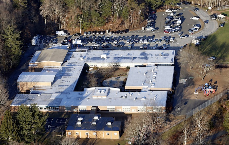 This Dec. 14, 2012 aerial file photo shows Sandy Hook Elementary School in Newtown, Conn. Contractors demolishing Sandy Hook Elementary School are being required to sign confidentiality agreements forbidding public discussion of the site, photographs or disclosure of any information about the building where 26 people were fatally shot in December 2012.