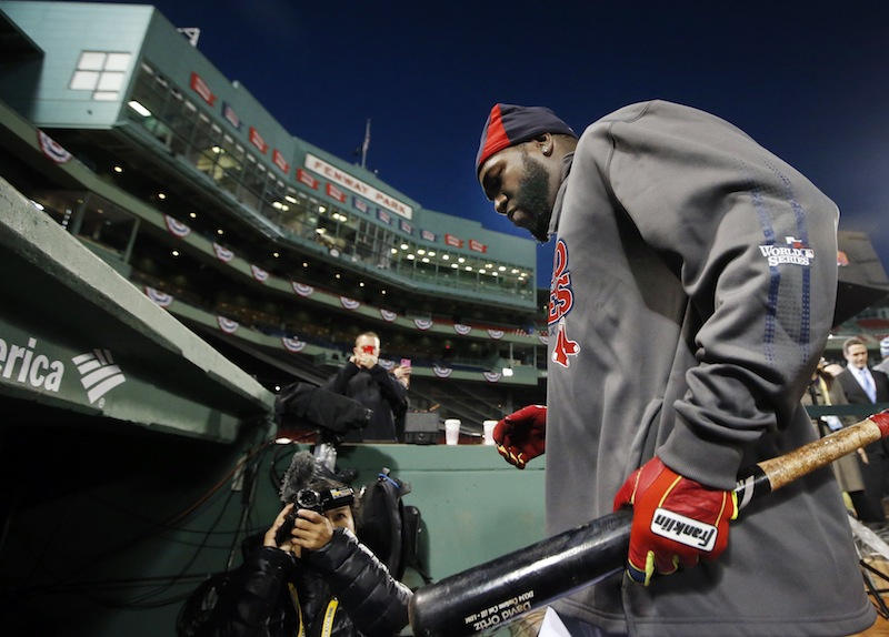 Boston Red Sox designated hitter David Ortiz walks into the dugout after a workout at Fenway Park in Boston, Tuesday, Oct. 29, 2013. The Red Sox are scheduled to host the St. Louis Cardinals in Game 6 of baseball's World Series on Wednesday.