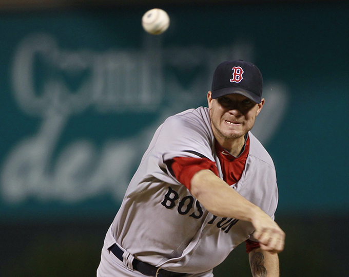 Boston Red Sox starting pitcher Jake Peavy works against the Colorado Rockies in a Sept. 25 game in Denver.