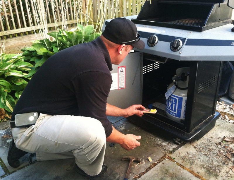 A pest control technician sets mouse traps and bait stations on the deck of a home in Rockville, Md. There's a health risk to having mice in the home, so be proactive, says Stuart Nichol of the Centers for Disease Control and Prevention.