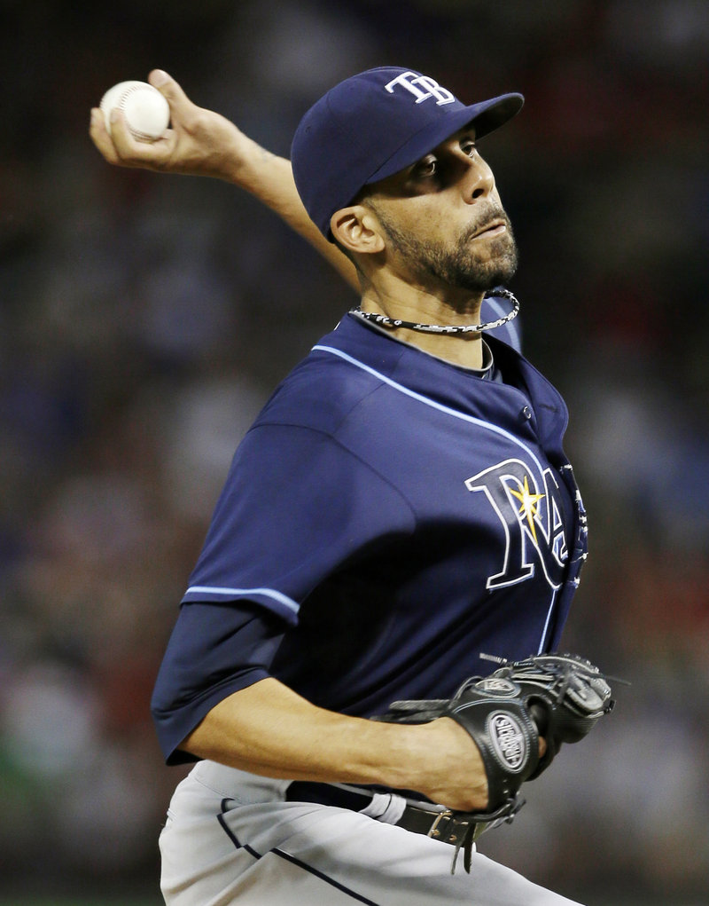 David Price improved to 10-8, throwing his fourth complete game of the season while allowing just seven hits in a 5-2 win Arlington, Texas.