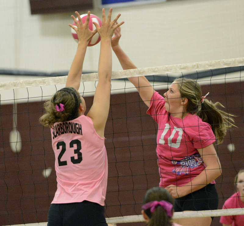 Mary Cleary of Scarborough has her hands in position to knock away a shot by Lauren Weickert of Greely.