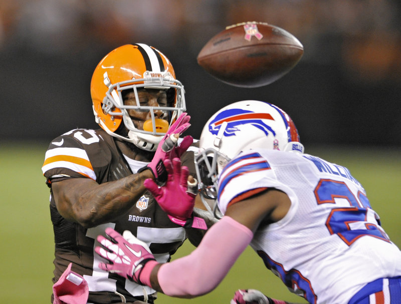 Buffalo safety Aaron Williams, right, breaks up a pass intended for Cleveland wide receiver Davone Bess during first-quarter action of Thursday night's NFL game in Cleveland, won by the Browns.