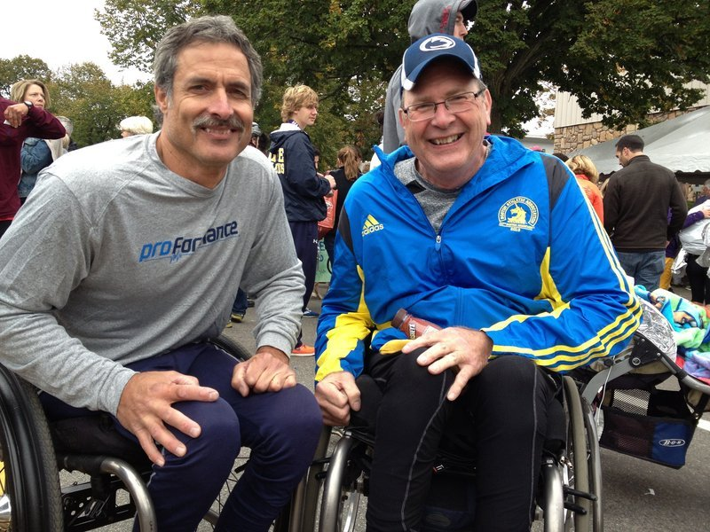 Wheelchair winner Grant Berthiaume, left, of Tucson, Ariz., shares a post-race moment with Paul Erway of Shelbyville, Ky., who finished third. They and runner-up Aaron Roux of Tucson are on a quest to complete 50 wheelchair marathons in 50 states in 50 weeks. Maine was No. 36. Berthiaume won in 2:19:57. Next weekend: Baltimore on Saturday and Chicago on Sunday.