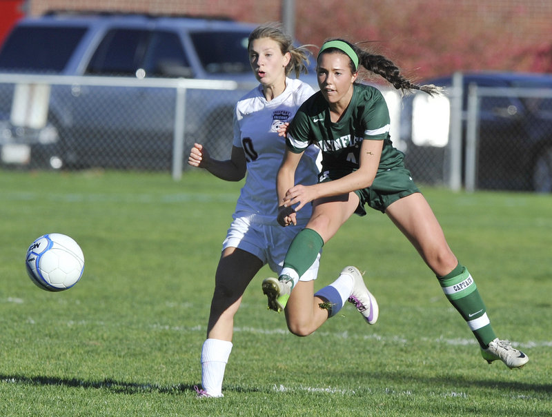 Helen Gray-Bauer of Waynflete, right, gets off a pass Tuesday ahead of Brooke Heathco of Freeport during their Western Maine Conference game. Waynflete reached 7-1-1 with a 2-0 victory. Freeport is 7-4.