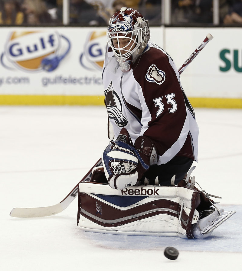 Jean-Sebastien Giguere of the Colorado Avalanche earned his 37th career shutout, making 39 saves in a 2-0 victory over the Bruins.