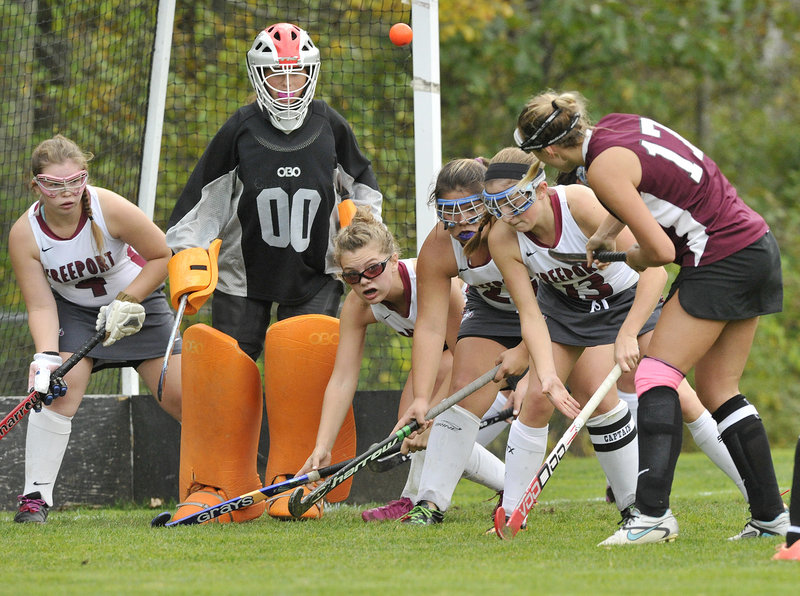 Cassie Demick of Greely lifts a high shot toward Freeport goalie Morgan Karnes during their Western Maine Conference field hockey game Friday in Freeport.