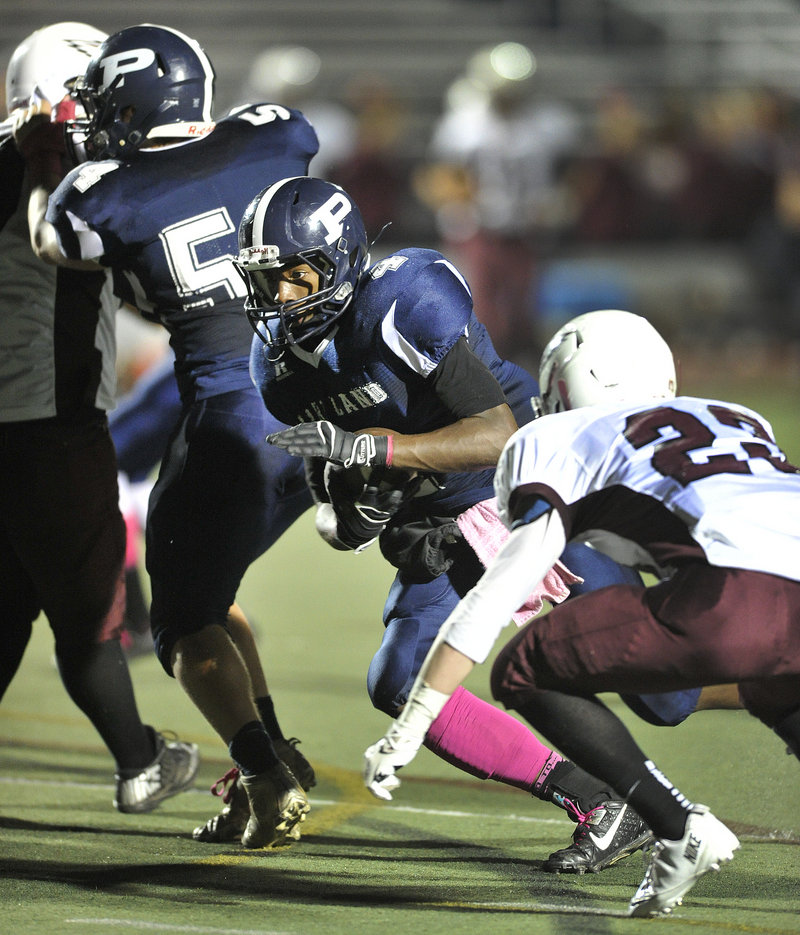 Jayvon Pitts-Young of Portland finds a hole to gain yardage Friday night during the Bulldogs' 57-14 victory against Windham at Fitzpatrick Stadium.
