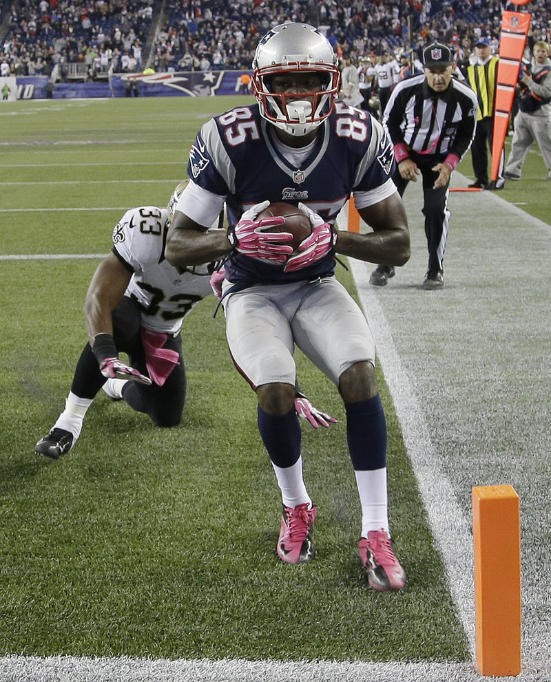 Kenbrell Thompkins beats Saints defender Jabari Greer to haul in a 17-yard touchdown pass that gave the Patriots a dramatic 30-27 win Sunday at Gillette Stadium.