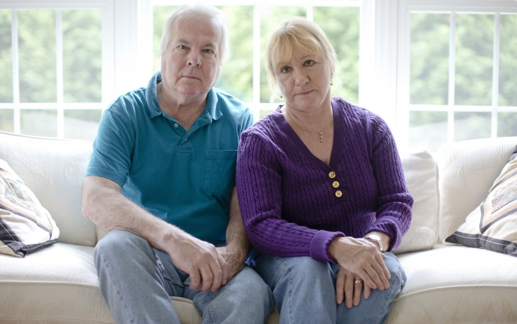 Dean and Mary Lou Griffin sit their home in Chadds Ford, Pa., on Friday. They are among millions nationwide who are receiving notices that their health insurance policies are being discontinued because they don't meet the higher benefit standards of the new law.