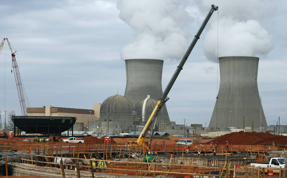 Part of the containment vessel for a new nuclear reactor at the Plant Vogtle power plant is shown under construction in Augusta, Ga., in 2012. Some of the world's top climate scientists say wind and solar energy will not be enough to head off extreme global warming, and they are asking environmentalists to support the development of safer nuclear power as one way to cut fossil fuel pollution.