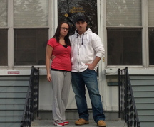 Teresa and Dan Reynolds stand in front of their Niagara Falls, N.Y., house in the neighborhood once known as Love Canal.