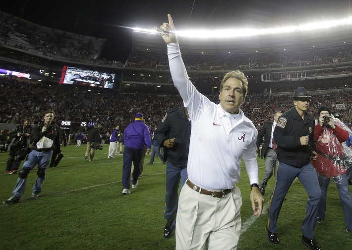 Alabama head coach Nick Saban runs off the field after the second half of an NCAA college football game against LSU, Saturday, Nov. 9, 2013, in Tuscaloosa, Ala. Alabama won 38-17.