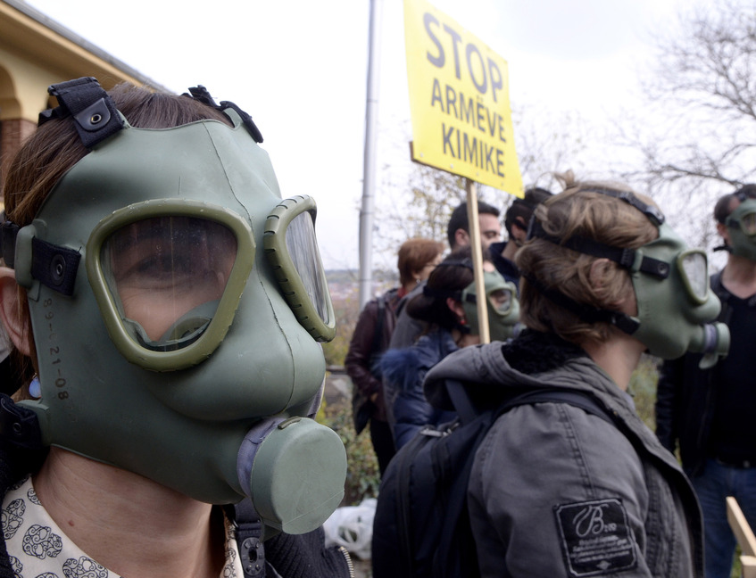 People wearing gas masks protest at the Albanian Embassy in Skopje, Macedonia, on Thursday. Separate rallies in Albania oppose plans to destroy Syrian chemical weapons in Albania.