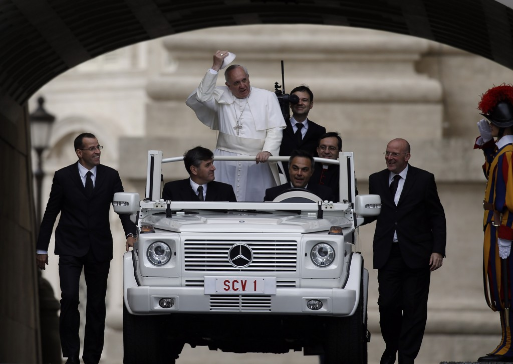Pope Francis, escorted by security guards, arrives in St. Peter's Square for the weekly general audience at the Vatican on Wednesday.