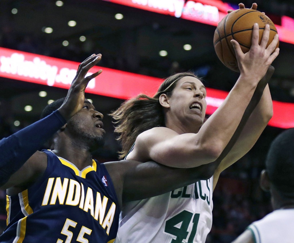 Boston Celtics center Kelly Olynyk battles for a rebound with Indiana Pacers center Roy Hibbert during Friday night's game won by the Pacers.
