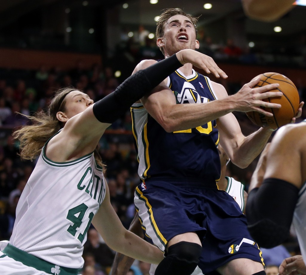 Utah Jazz forward Gordon Hayward (20) drives against Boston Celtics forwards Kelly Olynyk (41) and Jared Sullinger (7) during the first quarter of an NBA basketball game in Boston on Wednesday, Nov. 6, 2013. (AP Photo/Elise Amendola)