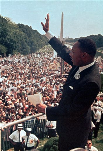 "In this Aug. 28, 1963 file photo, The Rev. Martin Luther King Jr. waves to the crowd at the Lincoln Memorial for his ""I Have a Dream"" speech during the March on Washington. The march was organized to support proposed civil rights legislation and end segregation."