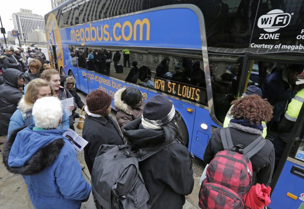 Passengers board a Megabus headed to St. Louis and Memphis on Tuesday in Chicago. The nation's bus industry has seen a drastic upgrade in recent years.
