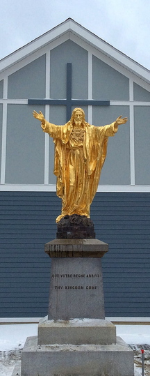The gold statue of Jesus Christ is back in Jackman after being vandalized in 2010 and repaired. It stands in front of the new St. Faustina Catholic Church.