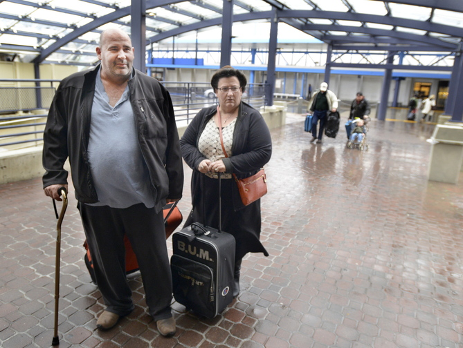 John Patriquin/Staff Photographer Carl Fecteau traveled from Louisville to Portland and described his flight as the most bumpy in all his years of travel. He was met by Sonia Gagnon of Portland.