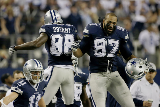 Dez Bryant of the Dallas Cowboys celebrates with Jason Hatcher after scoring a second-half touchdown Thursday en route to a 31-24 victory at home against the Oakland Raiders.