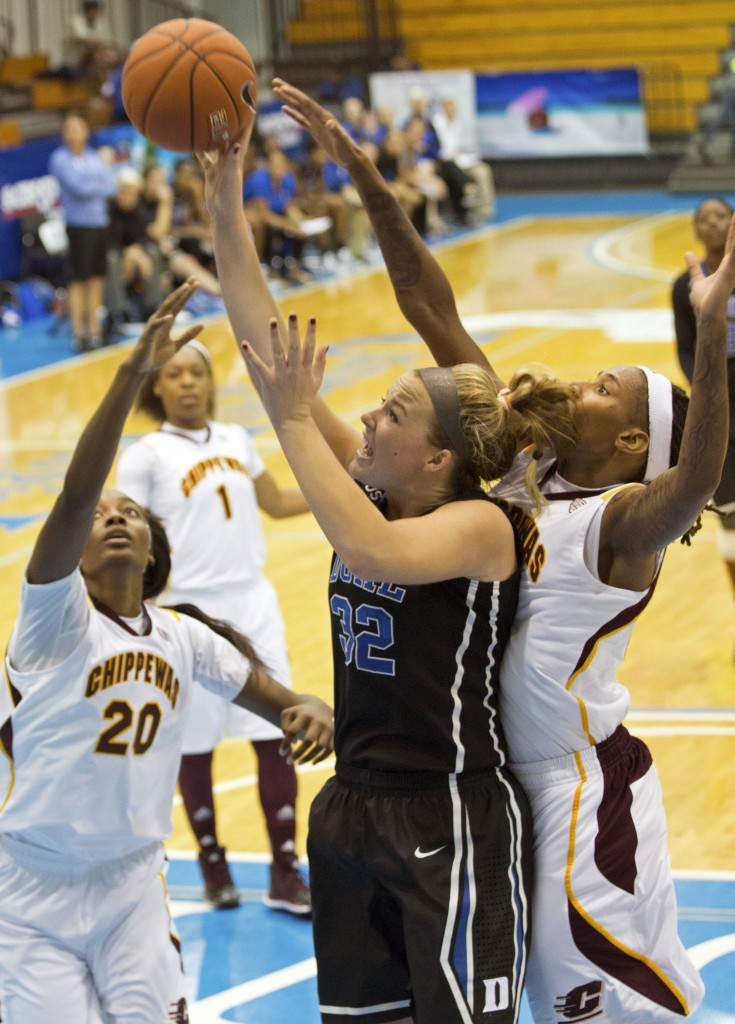 Duke's Tricia Liston, center, shoots against pressure from Central Michigan's Crystal Bradford, right, and Jewel Cotton during Friday's game in the Virgin Islands.