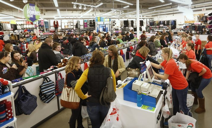Sales associates work the registers as a long line forms with Black Friday shoppers at Old Navy in South Portland shortly after midnight.
