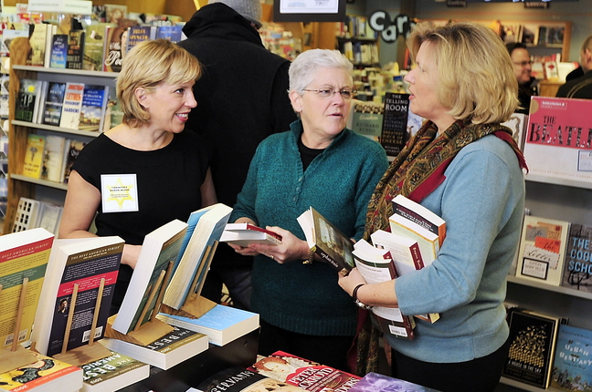 "Jeanne Hulit, acting administrator of the Small Business Administration, right, and Gina McCarthy, administrator of the EPA, middle, chat with Christina Baker Kline, author of ""Orphan Train,"" at Longfellow Books in Portland on Small Business Saturday."