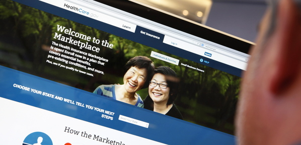 A man looks over the ACA signup page on the healthcare.gov website in this Oct. 2 photo illustration. Controversy over the fumbling of the website's rollout shouldn't be allowed to derail much-needed health care reform.