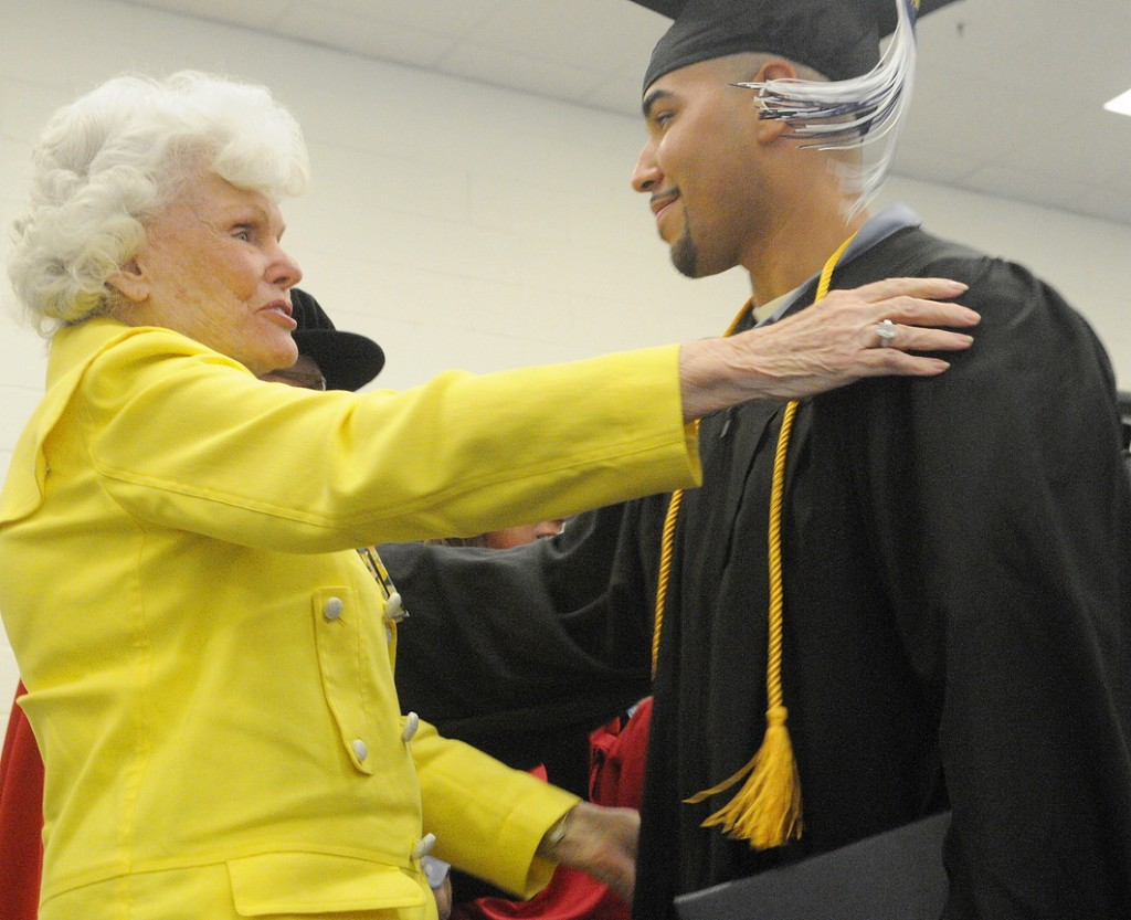 Maine State Prison inmate Sergio Hairston hugs philanthropist Doris Buffett on Monday after he received his diploma from the University of Maine at Augusta.