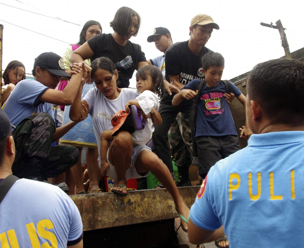 Residents in central Philippines are evacuated in anticipation of the powerful typhoon Haiyan.