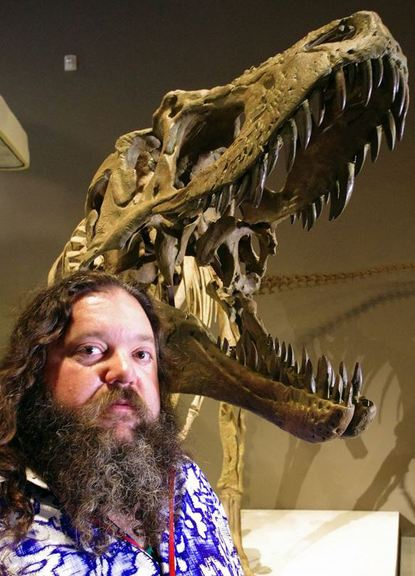 Paleontologist Mark Loewen is shown with the skeleton on display in Salt Lake City.