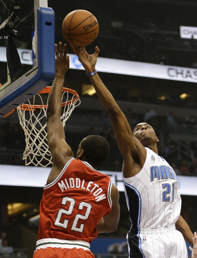 Maurice Harkless of the Orlando Magic blocks a shot by Khris Middleton of the Milwaukee Bucks during the first half of Orlando's 94-91 victory at home Wednesday night, snapping a three-game losing streak.