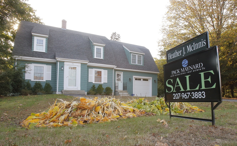 A for sale sign is posted in front of a home in Kennebunk in September. The number of Maine home sales continued its September increases into October.
