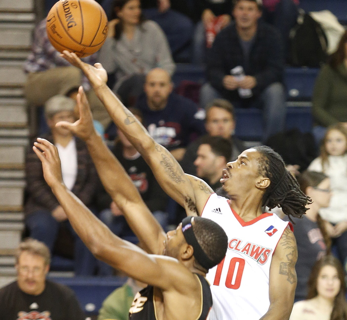 Maine's Marcel Anderson scores above Mustafa Shakur of Erie during the second quarter of the Red Claws' 127-100 win Sunday at the Expo.