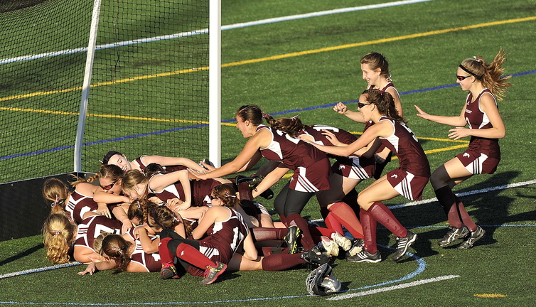 Gabe Souza/Staff Photographer Foxcroft Academy celebrates its victory over NYA in the Class C field hockey championship at Yarmouth High School Saturday, November 2, 2013.