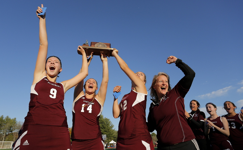 Gabe Souza/Staff Photographer Foxcroft's Amber Anderson, Mackenzie Coiley, Emily Higgins, and coach Stephanie Smith celebrate their victory over NYA in the Class C field hockey championship at Yarmouth High School Saturday, November 2, 2013.
