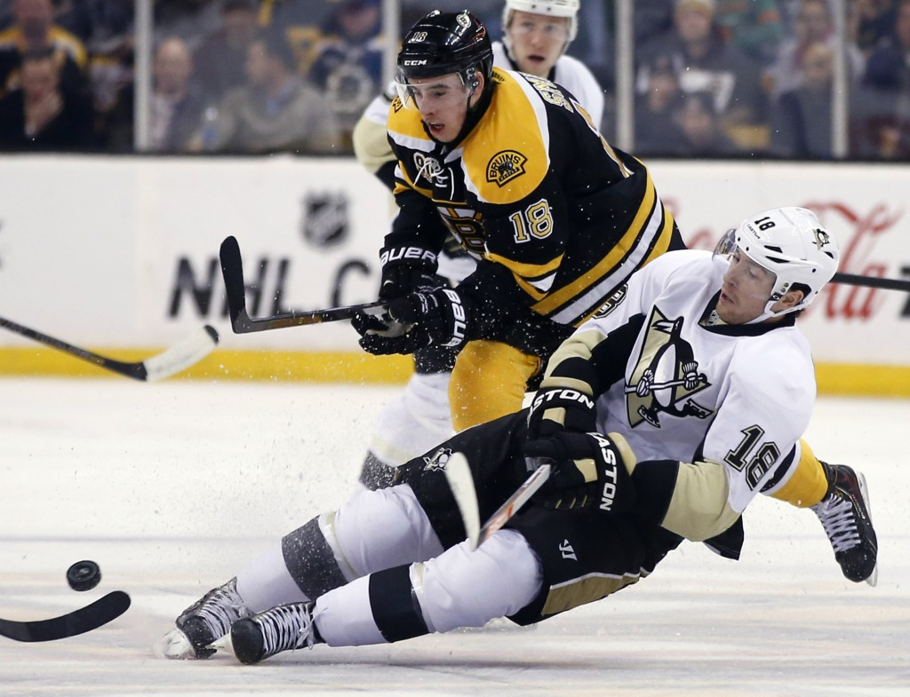 Penguins left wing James Neal (18) loses his edge while chasing the puck against Bruins right wing Reilly Smith (18) in the second period in Boston on Monday.