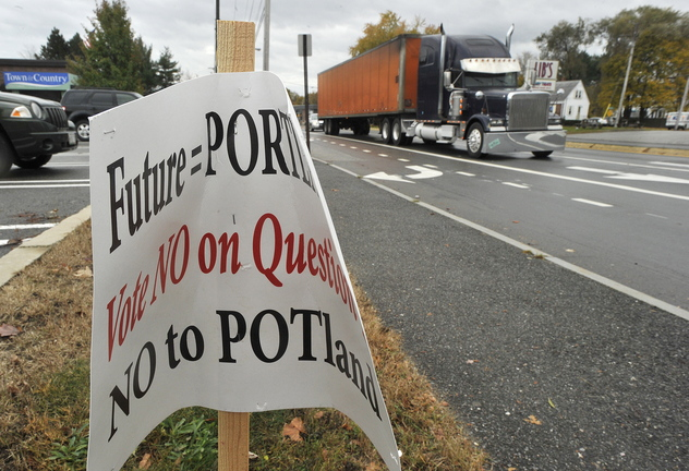 A sign advocating a no vote on Question 1, which asks to legalize marijuana in Portland, declares its position for people who use Auburn Street. The city admitted Friday that it overstepped when it removed several signs after receiving complaints about a lack of disclosure.