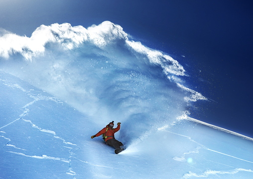 "Seth Wescott snowboards down a peak in Valdez, Alaska, in Warren Miller's film ""Ticket to Ride,"" being screened at Merrill Auditorium in Portland on Friday."