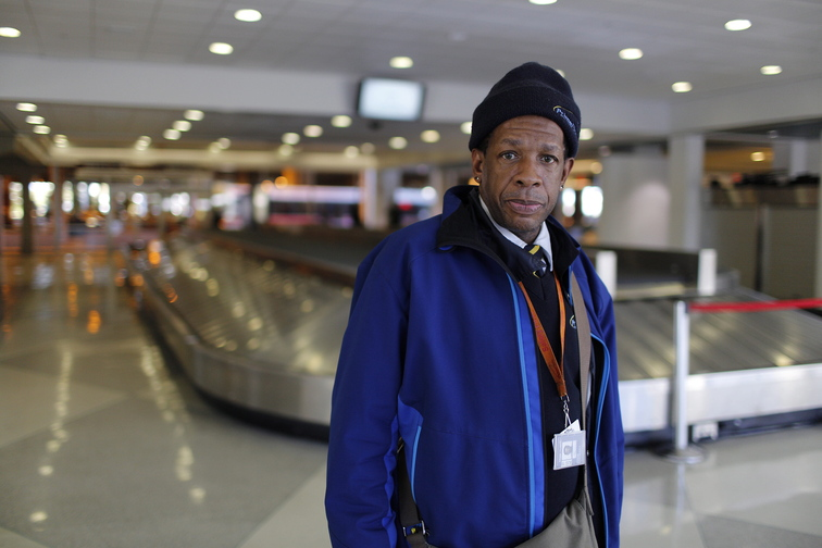 John Stewart works at the Philadelphia International Airport, escorting people in wheelchairs. He is paid $5.25 an hour, plus tips, and worries about paying his bills and losing his job.