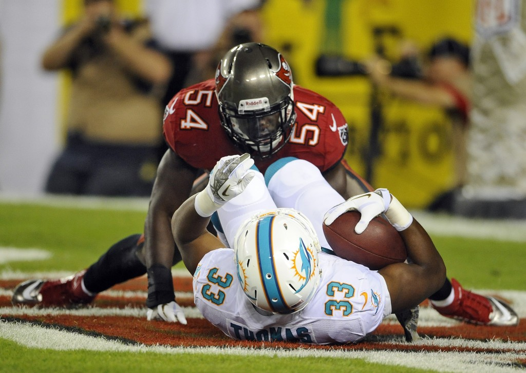 Tampa Bay Buccaneers outside linebacker Lavonte David (54) tackles Miami Dolphins running back Daniel Thomas in the end zone for a safety during the second quarter of an NFL football game Monday in Tampa, Fla.