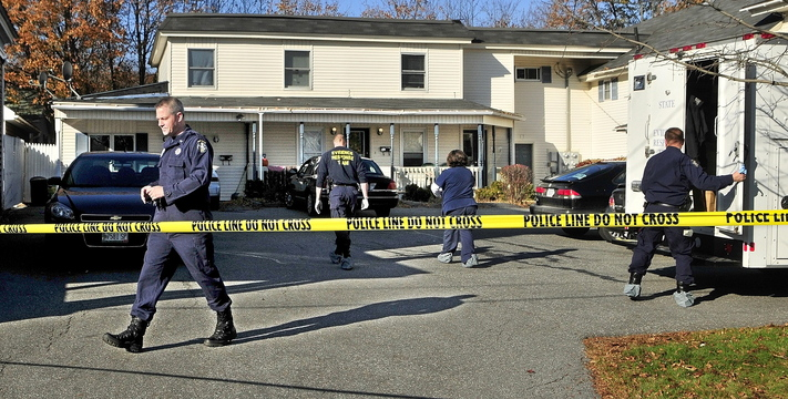 Investigators work at the scene of a killing Thursday at 32 Crosby St. in Augusta.