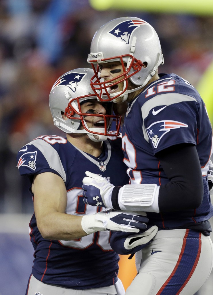 Receiver Danny Amendola, left, is congratulated by quarterback Tom Brady after catching his first touchdown pass as a New England Patriot during Sunday's rout of the Pittsburgh Steelers.