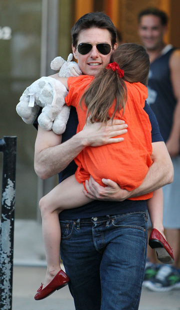 Tom Cruise, shown embracing his daughter, Suri Cruise, last July in New York, objects to criticism oft his parenting.