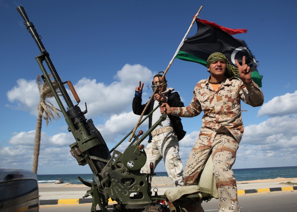 Libyan militias from towns throughout the country's west parade through Tripoli, Libya. Since the 2011 fall of autocrat Moammar Gadhafi, hundreds of militias have run out of control in Libya, carving out zones of power, defying state authority and often engaging in violence.