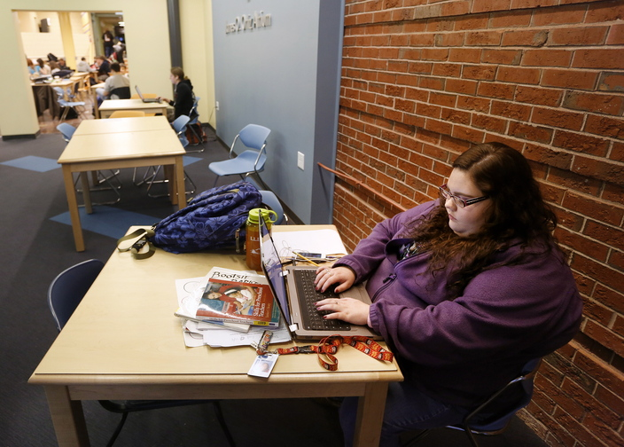 "Harleyanne Hustus, a third-year student majoring in early childhood development, works on her laptop Thursday. She plans to get a bachelor's from the University of Maine but came to SMCC first because it was less expensive. ""Working and interning – it's a lot,"" she said."