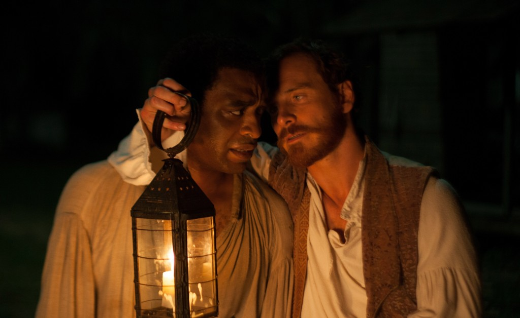 "The enslaved free man Solomon Northup, played by Chiwetel Ejiofor, and the deranged cotton farmer Edwin Epps, played by Michael Fassbender, in a scene from ""12 Years a Slave."""